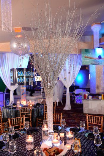 Bar Mitzvah Centerpieces | Crystal Centerpieces | Elegant Bar Mitzvah  These elegant white birch centerpieces were strung with hanging crystals to make an elegant Bar Mitzvah centerpiece. Courtesy of Lighter Than Air Events.
