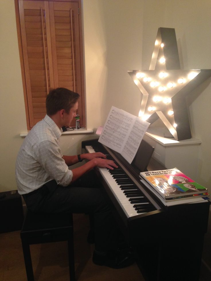 Yamaha eclectic piano with made.com Broadway floor lamp (and pet scouser who is pretty handy on the old Joanna)