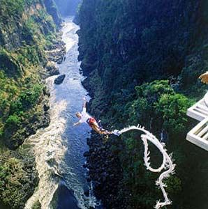 World's Wildest #Bungee_Jumping_Spots - Imagine perching on the skid of a helicopter, soaring 10,000 feet in the air, connected to the chopper by a bungee cord. Your destination? An active volcano, complete with a pool of #bubbling_lava, in Pucón, Chile. Once the helicopter is in position, directly over the inferno, the only thing left for you to do is take the plunge. And pray that the rope holds.