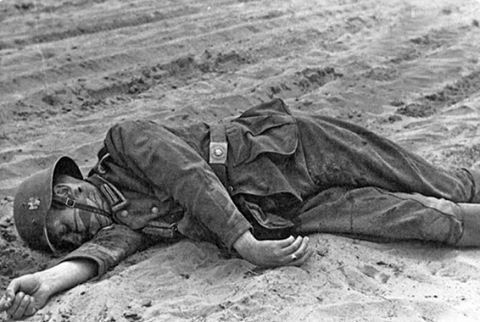 A dead German soldier with a neck puncture behind the ear. Unknown place and date.(sometime 1942-44?