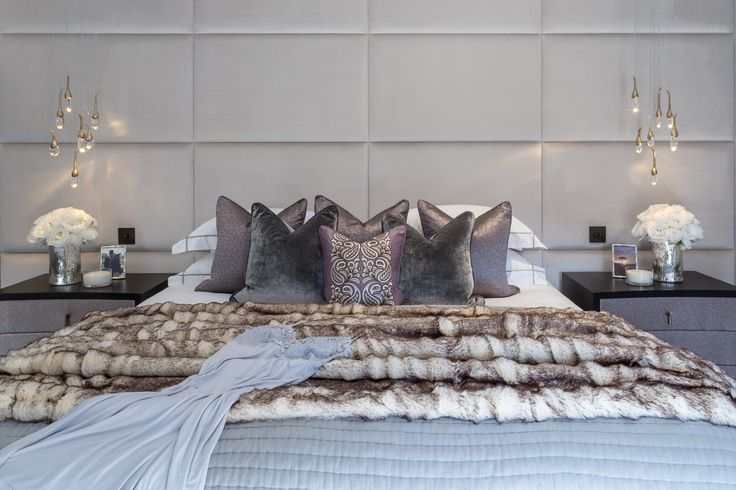 Offering a myriad of exquisite textures and luxurious tactile fabrics, this lavish master bedroom is made complete by the stunning upholstered Zimmer & Rohde wall. #interiordesign #luxurylife #luxury #london #luxuryproperty #luxuryhomes #londonproperty #luxuryinteriors