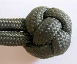 Its called lanyard knot. Another name would be false turkshead or knife lanyard knot.