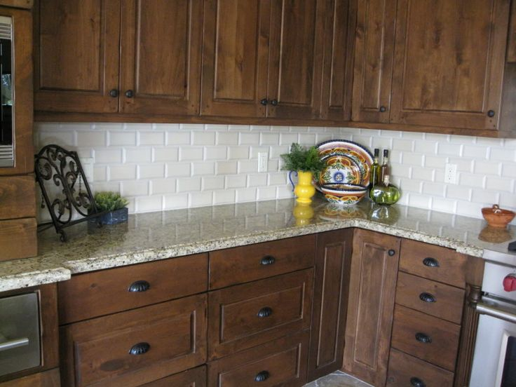 Venetian Gold granite, with a cream beveled subway tile backsplash and a light ceramic floor.