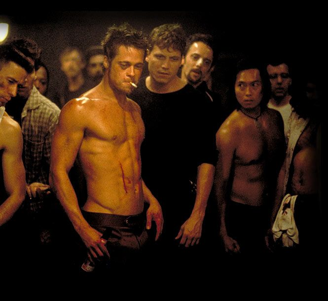 """To put it lightly, Fight Club depicts a world -- our world -- where men's dicks shrivel up due to the constant stimulation of consumerism. Edward Norton's nameless, routine-prone drone lives an IKEA-catalog existence. As he puts it: """"We used to read pornography. Now it's the 'Horchow Collection.'"""" The film's in-your-face penis motif begins with atesticular cancer support group (for men who have lost their balls) and ends with the spliced-in image of a big hairy cock."""