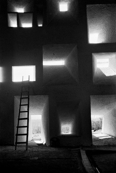 Rene Burri. FRANCE. Windows where painted glass panels will be mounted. Most of the slits for light widen to the interior of the edifice, some however on the exterior; the openings thus mediate between the two different worlds. 1955
