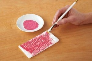 Paint on a paper towel and then use it to dab on your scrapbook paper for a cool texture look (smart!)