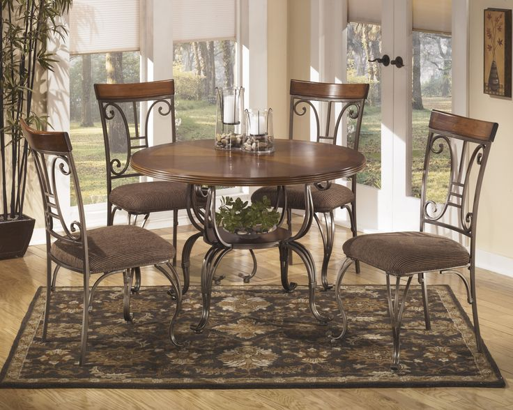 Plentywood Round Table 4 UPH Side Chairs By Signature Design Ashley Get Your At Furniture Factory Outlet
