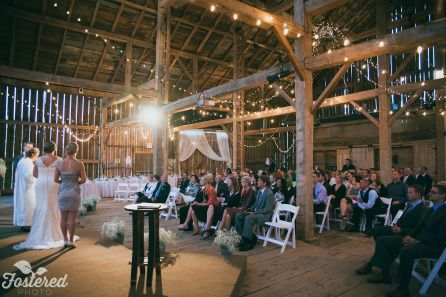 Sometimes Mother Nature brings the unexpected but thankfully Erin and Mike's ceremony in the barn was an absolute stunner! Photo Credit: Fostered Photo #cambiumfarms #barnwedding #torontobarnwedding #torontoweddingvenue #rustic #DIY #stunning #farm #countrywedding #caledon #elegance