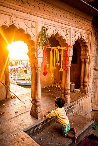 Little Indian boy watching the Traditional Krishna and Radha dance during the Flower Holi Festival, Vrindavan, Uttar Pradesh, India, Asia