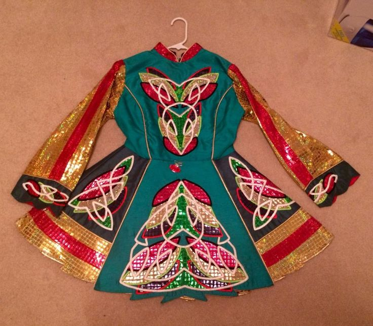 Teal, gold, green and red 3 panel Irish dance dress made of silk shantung. It was made in England by designer Paul Keith. I wore it for a few years, and it