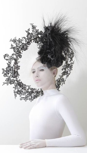 Hat by Philip Treacy from the Spring/ Summer 2014 collection.