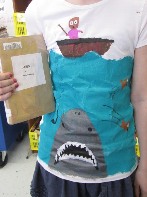 """Students read a book, designed and made a tshirt to advertise it and then tried to """"sell"""" it to their classmates w/o giving away the ending—fun!  Involves public speaking, persuasion, summarizing the main idea, graphic design that gets a message across, etc."""