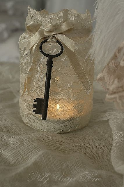 Beautiful lace over jar candle holder.  I think I would consider flameless candle if lace extends over top.