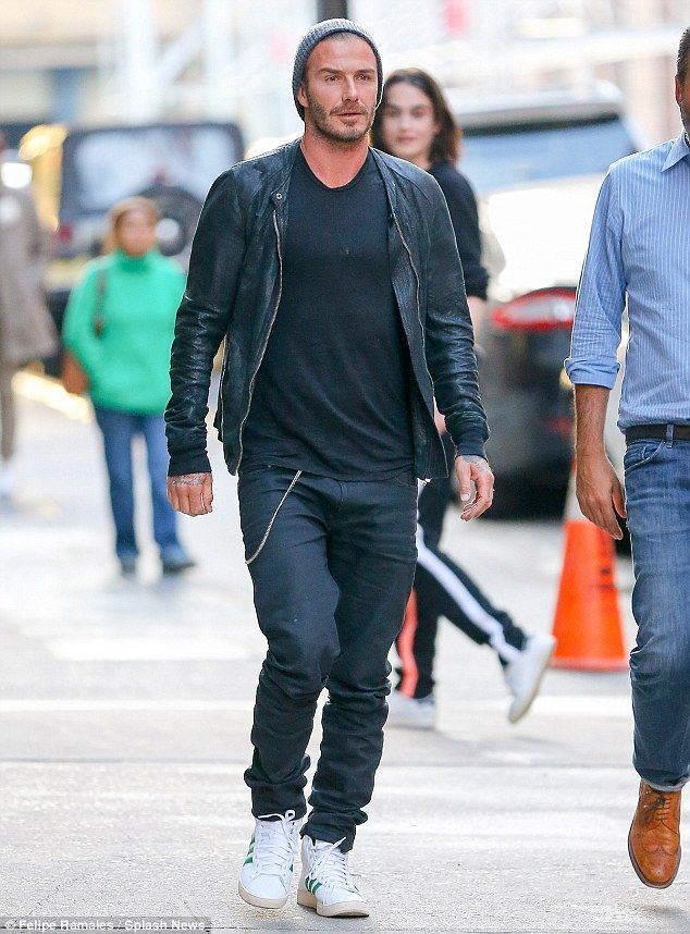 A face in the crowd: Beckham merged with passers-by during a stroll through the city on Thursday