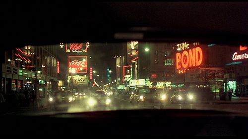 Times Square and the New York of 1976 seen through rear window of Travis Bickle's taxi in TAXI DRIVER