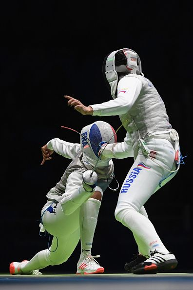 #RIO2016 Aida Shanaeva of Russia and Ysaora Thibus of France compete during the women's individual foil quarterfinal on Day 5 of the Rio 2016 Olympic Games at...