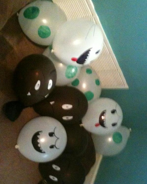 """""""Butt pinatas"""" lol balloons filled with candy and i painted to look like boos yoshi eggs and goombas"""