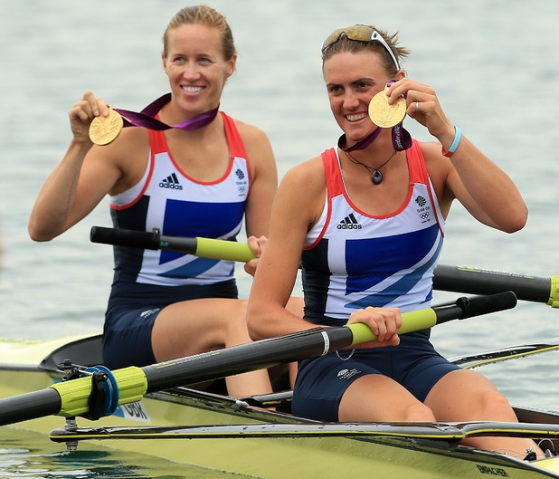 Great Britain's Helen Glover and Heather Stanning celebrate winning gold in the women's coxless pairs final during the 2012 Olympic Games.