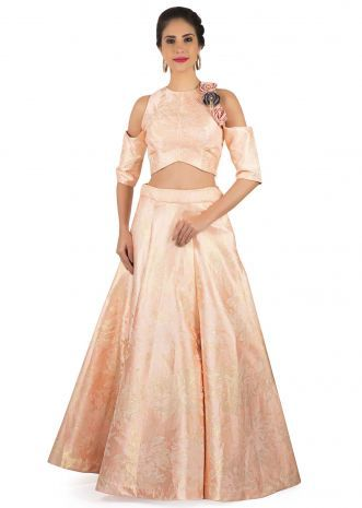 8de02c7c1d2 Blush peach lehenga in brocade matched with 3D flower embroidered crop top  only on Kalki