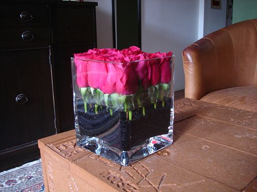 Idea- buds/flowers in vase with fish tank gravel (color options are endless)