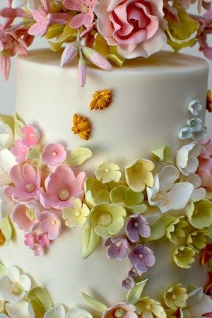 Love the intricate floral design on this cake! Would be perfect for a spring wedding, shower, birthday, or tea party!  #pink, yellow, purple, green, cake, spring, unique
