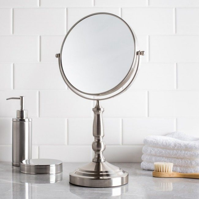 Make sure you look your best before you leave the house with an Upper Canada Danielle Silhouette Countertop Mirror.