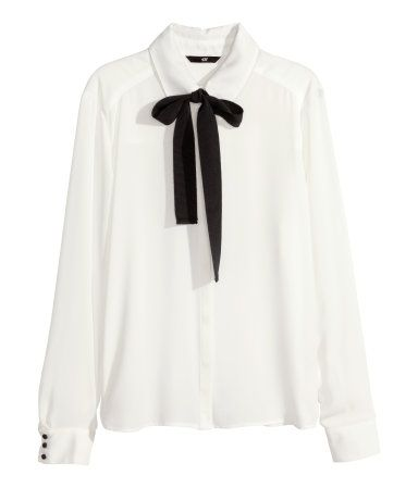H&M Blouse with a bow  Great with leather leggings for a night out on the town. Or jeans for a causal yet stylish look.