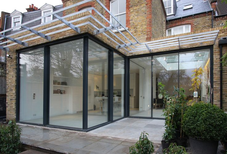Rear Residential Extension With Minimal Windows Sliding Doors