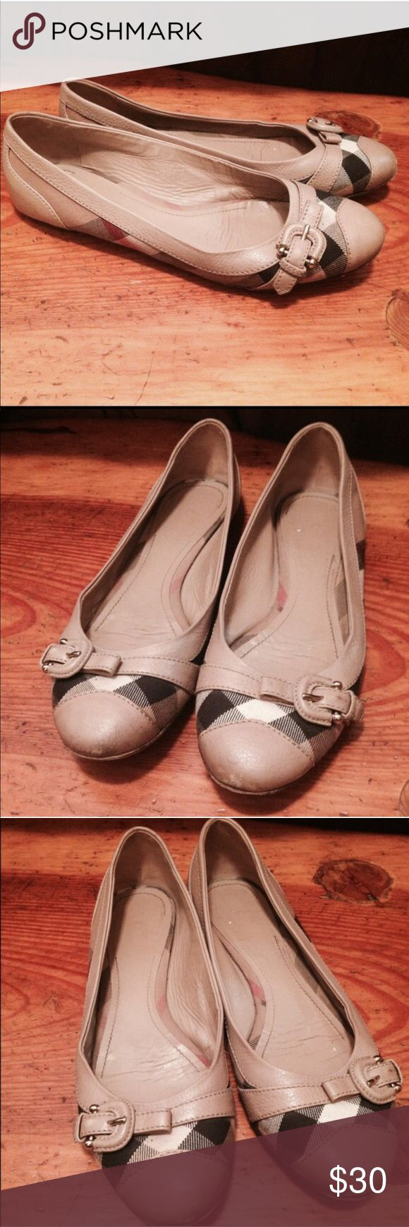Burberry flats with buckle Authentic Burberry leather flats with original checkers pattern. Comes with a detail buckle for looks, its worn out on the soles and actual shoes but still have tons of life left. Burberry Shoes Flats & Loafers