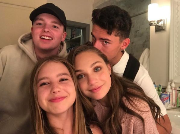 Maddie Ziegler and Her Boyfriend ~~~The dancer received a kiss on the head from Jack while hanging with friends.