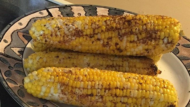 Roasted corn on the cob with Parmesan cheese and mayonnaise.      Ingredients  1/2 cup mayonnaise  5 ears corn, husk and silk removed  1 cup shredded Parmesan cheese     1 tablespoon chili powder  1 teaspoon salt  1 teaspoon ground black pepper