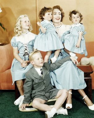 Joan Crawford posing with her children