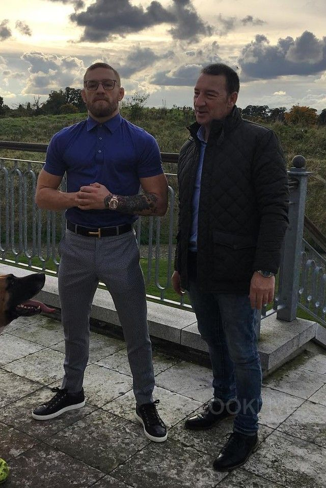 Conor McGregor wearing Lanvin Cap-Toe Suede and Patent-Leather Sneakers, Tom Ford Reversible Grained-Leather Belt, Hermès Polo Shirt