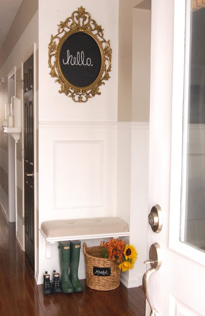Entryway-- small space idea. Flowers in basket... so cute.
