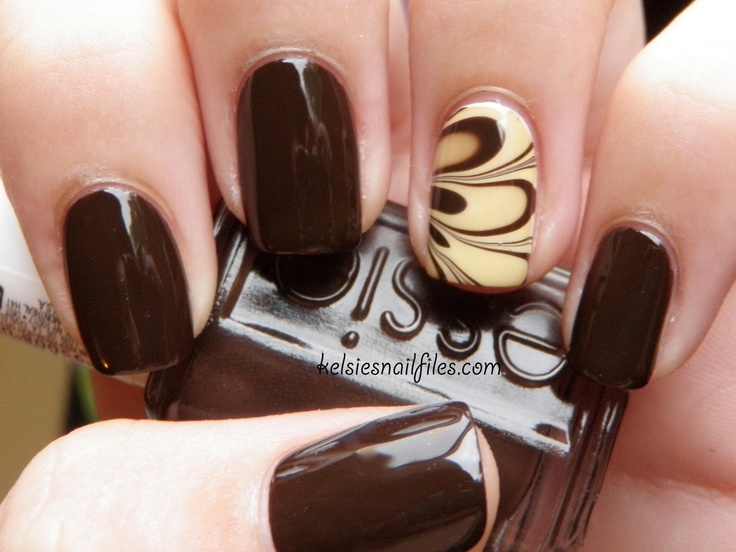 Thanksgiving water marble using Essie Little Brown Dress as the base & China Glaze Kalahari Kiss with LBD for the marble. | from Kelsie's Nail File