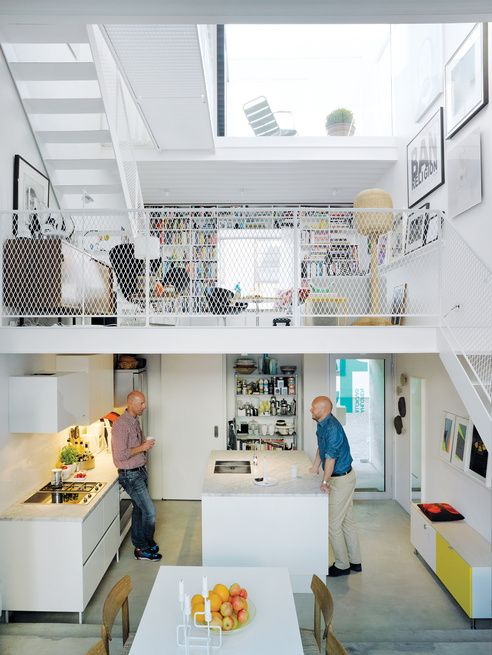 GUYS AND WALLSThree thin slabs, staggered vertically through this Nordic townhouse, create three distinct floors and allow light to flood in from the front, back, and roof. The white Saari kitchen makes the most of a compact space. Photo by Mark Seelen.  Photo by: Mark Seelen