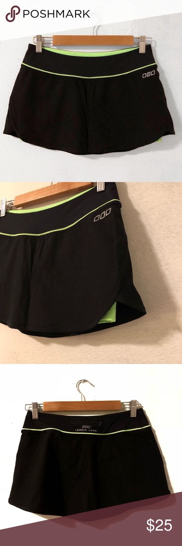 "Lorna Jane Skirt Skort Athletic Lorna Jane Athletic Workout Tennis Skirt/Skort Black and bright neon green. Perfect condition.  cute tennis skort with neon green shorts underneath.  I don't know what size this is and cannot find a size tag anywhere.  (a friend gave me this to sell). It is about the same size as a 4 in Lululemon.  So it's a 2-4 or XS if I had to guess. waist flat unstretched is 13"". Length is 10.5"".  The shorts liner has an inseam of 3"". Reflective details, zip back pocket…"