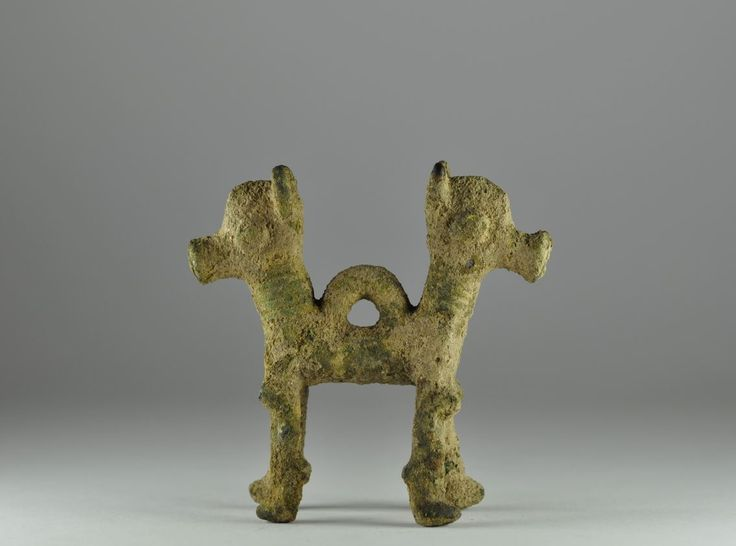 Iranian bronze pendant in the form of foreparts of two horses, 9th-8th century B.C. Luristan Iran bronze pendant in the form of foreparts of two horses, back-to-back with horizontal cording rising the height of each neck in broad choker arrangement, central suspension loop, 8.2 cm high. Private collection