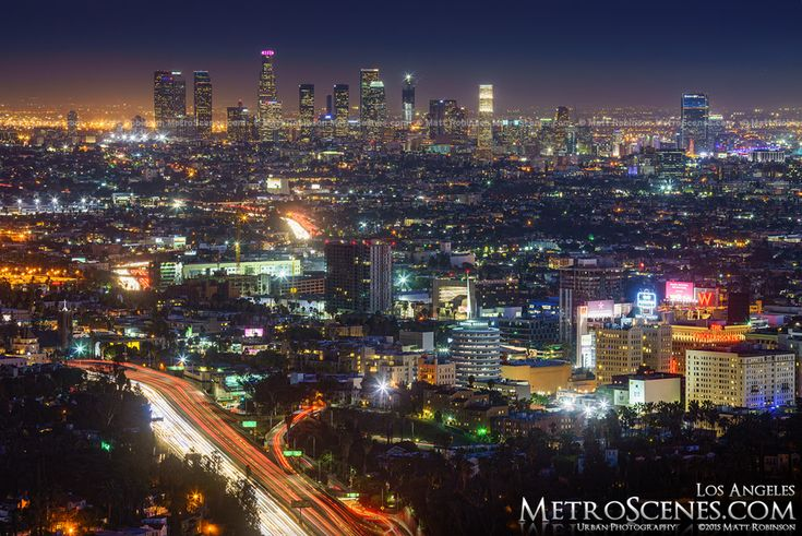 Los Angeles Skyline at night with traffic on the freeway with Wilshire Grand Tower