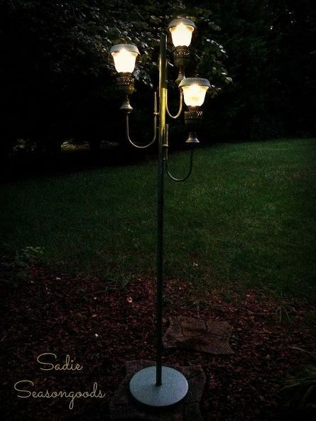 An old floor lamp is upcycled into an outdoor night light - so cool!