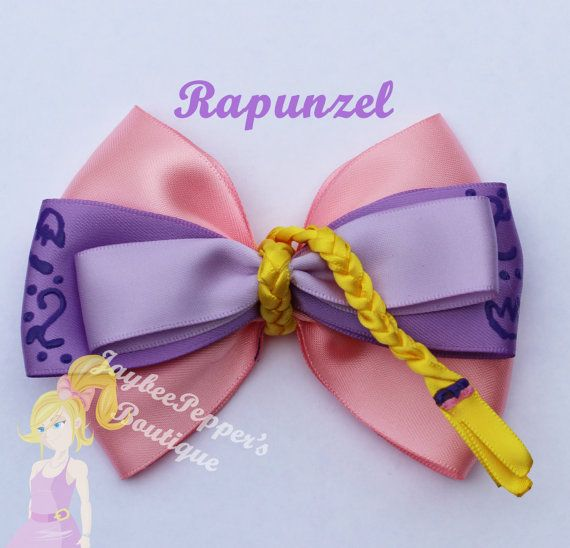Rapunzel inspired hair bow. Measures about 4.5 across.    All bows are made in a smoke free environment and the ends of the bows are heat sealed to