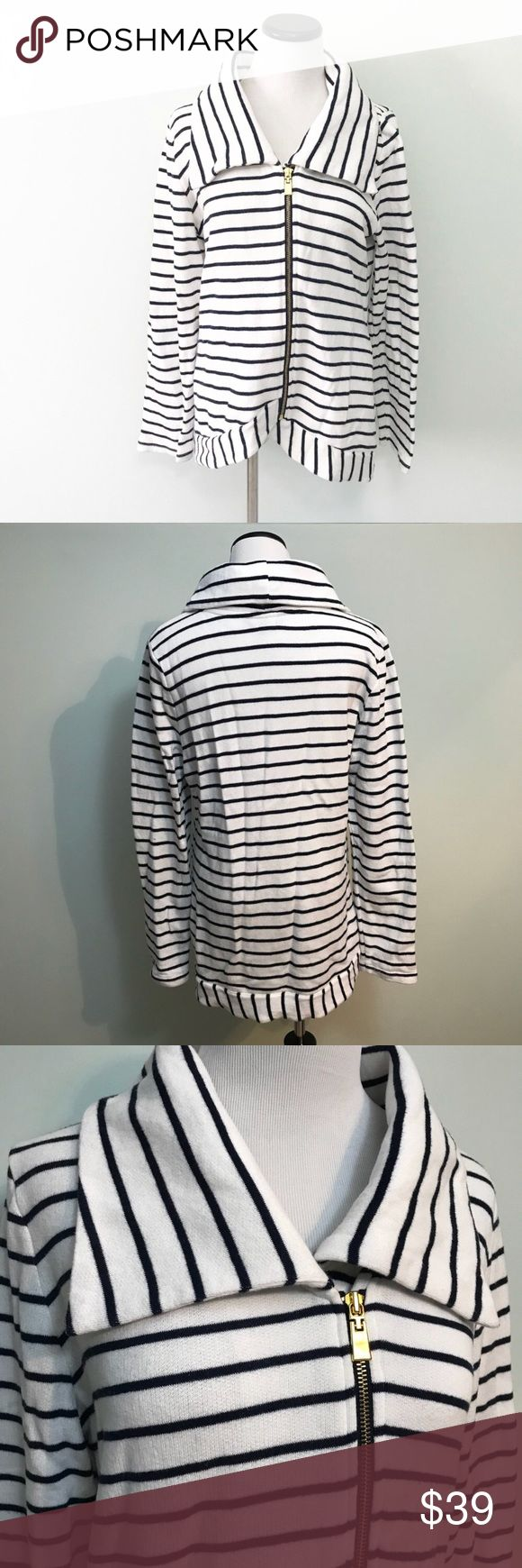 """TOMMY HILFIGER White Navy blue zip up Sweater Tommy Hilfiger Navy blue and white striped zip up Jacket sweatshirt. Sweatshirt material. Gold colored zipper. Slight hi low design. Length in front 26"""". Chest 21.5"""". Side pockets. Big shawl collar. Tommy Hilfiger Sweaters"""