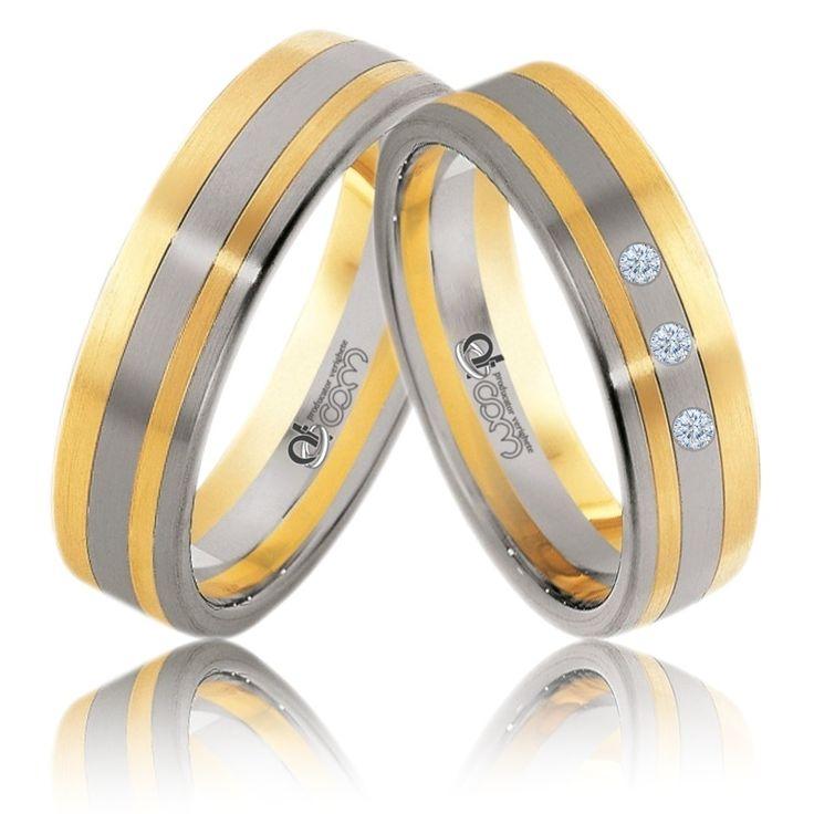 Verighete ATCOM ATC177 aur alb cu galben. Pe inelul damei sunt incrustate 3 pietre de zirconiu / diamante.