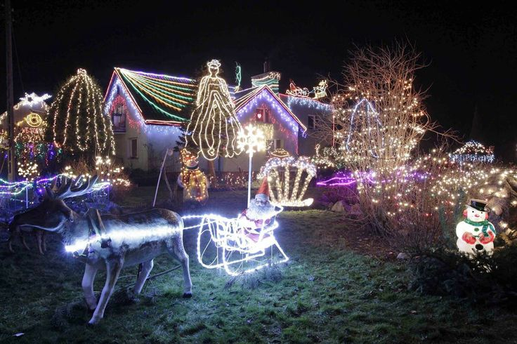 Christmas lights decorate the home of the Duszenko family in Polkowice, southwestern Poland, on Dec. 18. The family used around 52,000 lights in their display.
