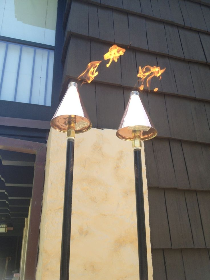 copper tiki torches give the same stunning lighting effect as traditional torches without the