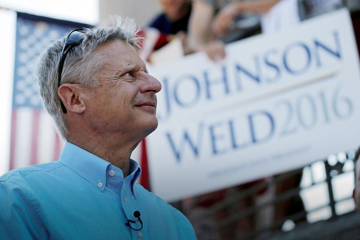 Libertarian presidential candidate Gary Johnson listens as his running mate vice presidential candidate Bill Weld speaks at a campaign rally in Boston, Mass. on Aug. 27, 2016. (Photo by Brian Snyder/Reuters)