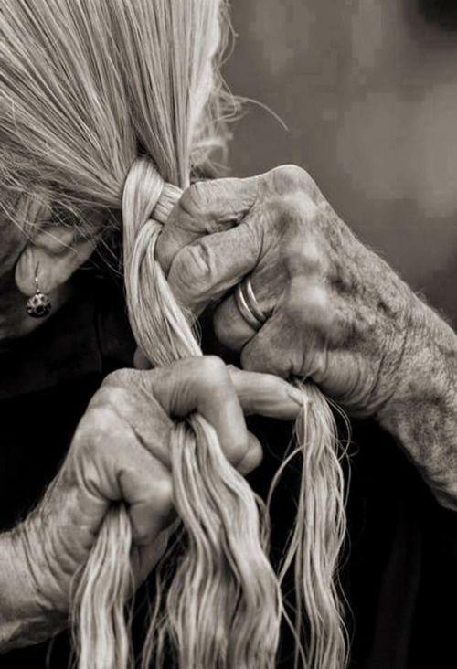 Old hands perform a daily pleasure. I remember my grandmother doing this. It seemed her hair knew just what to do as she plaited without looking!