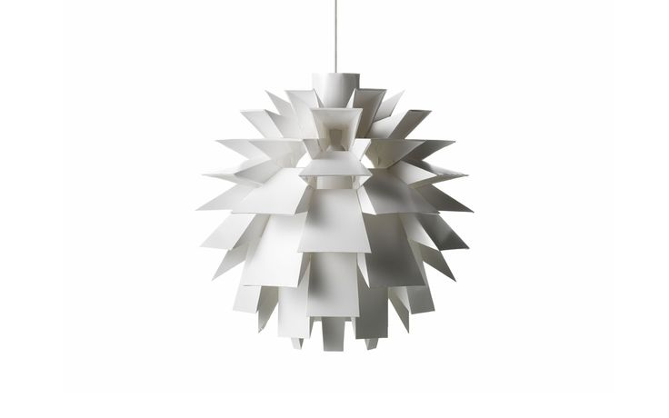 X-large White Norm 69 Lamp.  The Norm 69 lamp holds a special place in the Normann-Copenhagen legacy. The edgy self-assembly lamp was the first product launched in 2002 and is designed by Simon Karkov. It comes in different sizes - small, large, x-large and xx-large.