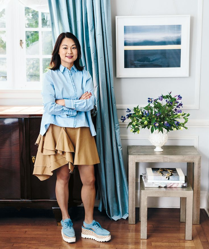 Blue oxford shirt, platform tennis shoes, beige ruffle skirt