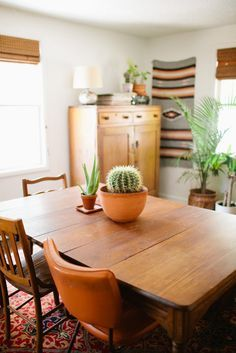 Love the mismatched chairs!